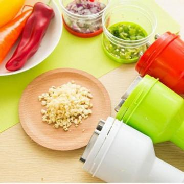 New Practical Garlic Onion Pressing Gadget Slicer Peeler Green Kitchen Tool