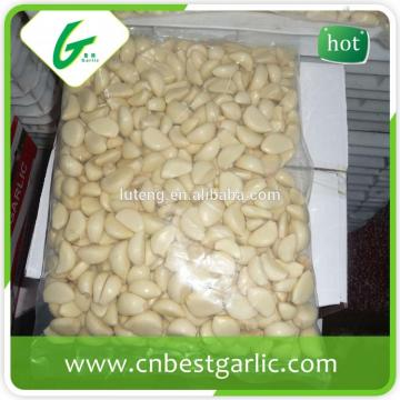 White pure peeled frozen garlic cloves