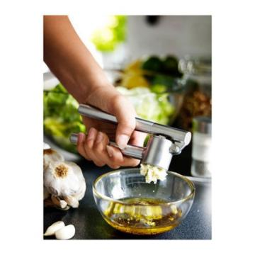 IKEA stainless steel garlic press removable insert sturdy kitchen tool KONCIS
